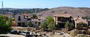 Progress photo of the two model homes for the Legacy Collection in Covenant Hills by Warmington Homes